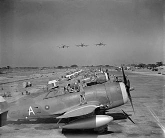 History of aviation in Bangladesh - Thunderbolt Mark Is of No. 135 Squadron RAF lined up, being overflown by three other Thunderbolts at Chittagong