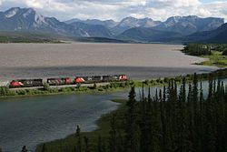 Train passing Brûlé Lake Alberta.jpg