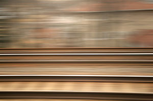 Train tracks, taken from a moving train.