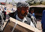 Troops Drop Off Needed School Supplies DVIDS323590.jpg