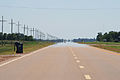Truck approaching in Mississippi. I was driving on this straight road myself, saw the big truck in the mirror, speeded up to increase the distance, and stopped to take the photo. (9426900661).jpg