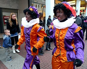Sinterklaas - Two Dutch women in costume as Zwarte Piet