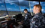 Two air traffic controllers from No 452 Squadron RAAF in RAAF Darwin's control tower during 2018.jpg
