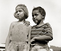 Two young American girls photographed at an Inter-racial Christmas Seals Camp in August 1943