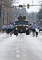 U.S. Air Force military working dog handlers and an armored vehicle lead the way up Randall Avenue during a 90th Security Forces Group pride run March 29, 2013, at F.E. Warren Air Force Base, Wyo 130329-F-JW079-116.jpg