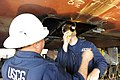 U.S. Coast Guard Chief Warrant Officer Rick Nieves, left, and Chief Warrant Officer Dave Getchell, vessel inspectors with Coast Guard Sector Anchorage, inspect welds on the ferry Tustumena in Seward, Alaska 130731-G-ZR723-002.jpg