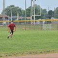U.S. Coast Guard Seaman Josh Will, assigned to the icebreaker USCGC Morro Bay (WTGB 106), runs to catch a pop-up ball during his unit's softball practice July 31, 2013, at Kennedy Field in Cleveland 130731-G-KB946-030.jpg