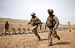 U.S. Marine Corps 1st Lt. Brent Bonnema, left, and Cpl. Fred Barba run between stations while conducting small arms live-fire training at Camp Leatherneck in the Helmand province of Afghanistan on April 25, 2013 130425-M-YH552-250.jpg