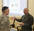U.S. Marine Corps Sgt. Maj. Nicholas Deabreu, right, the battalion sergeant major of Black Sea Rotational Force 13, speaks with a Georgian soldier during a noncommissioned officer seminar March 20, 2013 130320-M-ZP546-049.jpg