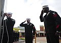 U.S. Navy Counselor 1st Class Aaron Castillo, left, prepares to raise the flag as Aviation Boatswain's Mates Handling 1st Class Rhoan Brown, center, and Terrone Wolliston salute during a 9-11 remembrance 120911-N-FR671-018.jpg