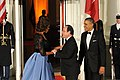 U.S. President Barack Obama, second from right, and first lady Michelle Obama, second from left, welcome French President Francois Hollande, center, to the State Dinner at the North Portico of the White House 140211-A-WP504-078.jpg