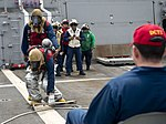 U.S. Sailors simulate investigating a crash site during a crash and salvage drill aboard the guided missile destroyer USS William P. Lawrence (DDG 110) Aug. 30, 2013, in the Arabian Sea 130830-N-ZQ631-020.jpg