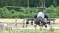 U.S. Soldiers with Echo Company, 2nd Battalion, 159th Aviation Regiment, 12th Combat Aviation Brigade refuel an AH-64D Apache Longbow helicopter July 31, 2013, in Oberdachstetten, Bavaria, Germany 130731-A-OE523-018.jpg