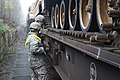 U.S. Soldiers with the 2nd Battalion, 12th Cavalry Regiment remove an iron rail from a train to unload M1A2 Abrams tanks in Parsberg, Germany, Oct. 18, 2014, during Combined Resolve III 141018-A-EM978-007.jpg
