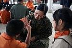 U.S. and Thai service members volunteer at school for disabilities 150212-M-MH123-230.jpg