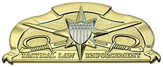 Deployable Operations Group - Tactical Law Enforcement Badge worn by qualified TACLET members.