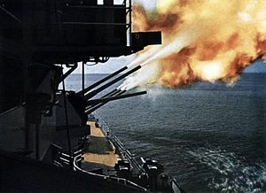 USS Toledo (CA-133) - Toledo firing her forward guns.