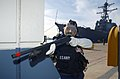US Navy 021205-N-6501M-046 gas mask donned and her shotgun ready.jpg