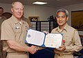 US Navy 030712-N-9999K-009 Capt. Jose. R. Corpus, right, Chief of Staff for Carrier Group 5, is presented the Bronze Star Medal.jpg