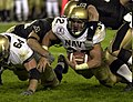 US Navy 031206-N-9693M-501 Kyle Eckel is tackled after a substantial gain during the 104th playing of the Army Navy game.jpg