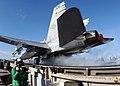 US Navy 040127-N-7326H-021 Photographer's Mate Airman Jonathan Cirino from Jacksonville, Fla., provides video coverage of an F-A-18C Hornet.jpg