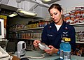 US Navy 040724-N-0535P-007 Photographer's Mate 2nd Class Andrea Decanini uses her new Navy Cash Card in the ship's store aboard USS Harry S. Truman (CVN 75).jpg