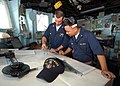 US Navy 040729-N-4374S-009 Quartermaster 3rd Class Seth Rau and Ensign Tin Tran plot the ship's course on the navigational chart in the pilot house aboard the mine countermeasure ship USS Dextrous (MCM 13).jpg