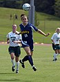 US Navy 040829-N-9694M-004 U.S. Naval Academy Midshipman Nicole Waggoner, foreground, heads the ball away from George Mason University's Allison Cowan during a regular season soccer match.jpg