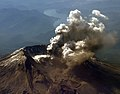 US Navy 041001-N-9500T-009 Mount St. Helens emits a plume of steam and ash from an area of new crevasses in the crater glacier south of the 1980-86 lava dome.jpg