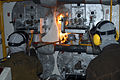 US Navy 041018-N-5467J-006 man Recruit Edroy C. Francis inserts a hot torch into the fire box of boiler number two aboard the amphibious assault ship USS Bataan (LHD 5).jpg