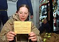 US Navy 041023-N-6125G-105 Personnelman 1st Class Stephanie Jackson reads the Chemical, Biological and Radiology card to the rest of the internal investigation team.jpg