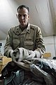 US Navy 050414-N-6628F-008 Storekeeper 1st Class Richard Harris, a reservist assigned to Naval Expeditionary Logistics Support Force Reservists (NAVELSF), Forward Oscar, Alpha Company, performs a customs inspection.jpg