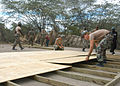 US Navy 050416-N-0507C-009 New Horizons Task Force Personnel construct wooden floors for tents in Gonaives, Haiti.jpg