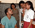 US Navy 050427-N-0357S-014 Dental Technician 3rd Class Ryan Hill teaches students the proper use of a toothbrush at a school on the island of Nias.jpg
