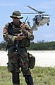 US Navy 050630-N-7293M-116 Master-at-Arms 2nd Class Jackson J. Stasny listens to a call on his radio.jpg
