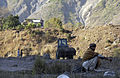 US Navy 051113-F-2729L-017 A U.S. Navy Seabee assigned to Naval Mobile Construction Battalion Seven Four (NMCB-74), levels the ground in Muzaffarabad, Pakistan.jpg