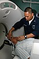 US Navy 060822-N-3532C-079 Navy Hospital Corpsman 2nd Class Ronald Bayaca of San Diego, prepares a patient for a CAT scan aboard the Military Sealift Command (MSC) hospital ship USNS Mercy (T-AH 19), during the ship's vis.jpg