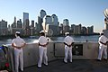 US Navy 060911-N-0191T-030 Sailors aboard the amphibious transport dock ship USS San Antonio (LPD 17) man the rails as the newest ship in the Atlantic Fleet passes Ground Zero in New York City.jpg
