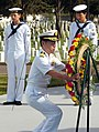 US Navy 070613-N-4163T-010 Captain Takanari Murata, commander, Escort Division 4 Japan Maritime Self-Defense Force (JMSDF), places a wreath on its stand during a wreath-laying ceremony at Fort Rosecrans National Cemetery.jpg