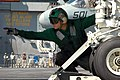 US Navy 070620-N-8119R-175 Aviation Boatswain's Mate (Equipment) 2nd Class Ricky Criswell signals that an F-A-18E Super Hornet, assigned to the Tophatters of Strike Fighter Attack Squadron (VFA) 14, is hooked up to the ca.jpg