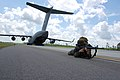 US Navy 080614-N-1057H-195 Sailors assigned to Naval Mobile Construction Battalion (NMCB) 11 set up a secure 360-degree perimeter around the U.S. Air Force C-17 aircraft.jpg