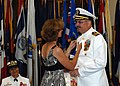 US Navy 080814-N-9527B-001 Capt. Bruce Gillingham is pinned with his command pin by his wife.jpg