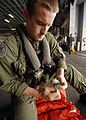 US Navy 080915-N-6439C-022 Aviation Warfare Systems Operator Airman Chris Carpenter performs operational checks on search and rescue gear.jpg