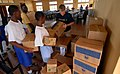 US Navy 090324-N-1688B-010 Students from Pacelli School of the Blind in Lagos Nigeria help Operations Specialist Seaman Reilly Mealer stack Operation Handclasp donations.jpg