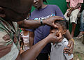 US Navy 090416-N-1655H-126 Hospital Corpsman 2nd Class Sule Abiodun, a member of the Africa Partnership Station Nashville Department of Defense medical team, tests the vision of a school girl in Libreville.jpg