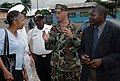 US Navy 090422-N-1655H-161 Chief Builder Paul Reed discusses Africa Partnership Station Nashville community outreach projects with U.S. Ambassador to Gabon Eunice Reddick.jpg
