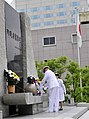 US Navy 090703-N-8273J-182 Chief of Naval Operations (CNO) Adm. Gary Roughead participates in a wreath laying ceremony while visiting Ichigaya in Tokyo.jpg