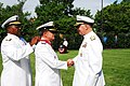 US Navy 090715-N-8732C-048 Chief of Naval Operations Adm. Gary Roughead, right, congratulates Commander of the Colombian National Navy, Adm. Guillermo Enrique Barrera Hurtado, while Rear Adm. Julius Caesar, left, secures the Le.jpg