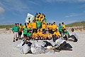 US Navy 090716-N-0486G-005 Sailors assigned to the guided-missile destroyer USS The Sullivans (DDG 68) stand behind the trash they collected during the mid-summer beachfront clean up at Naval Station Mayport.jpg