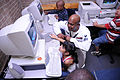 US Navy 091005-N-6220J-010 Navy Counselor 1st Class Timothy Smith, assigned to Navy Recruiting District Raleigh, tutors a young participant in the computer lab.jpg